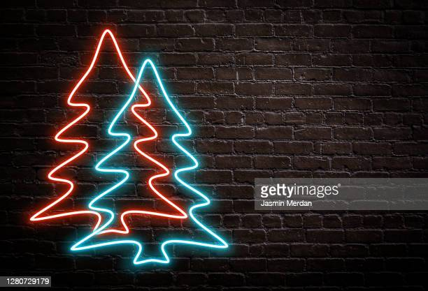 neon christmas tree on brick wall - christmas tree stock pictures, royalty-free photos & images