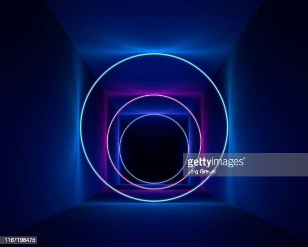 neon circles - fluorescerende stockfoto's en -beelden