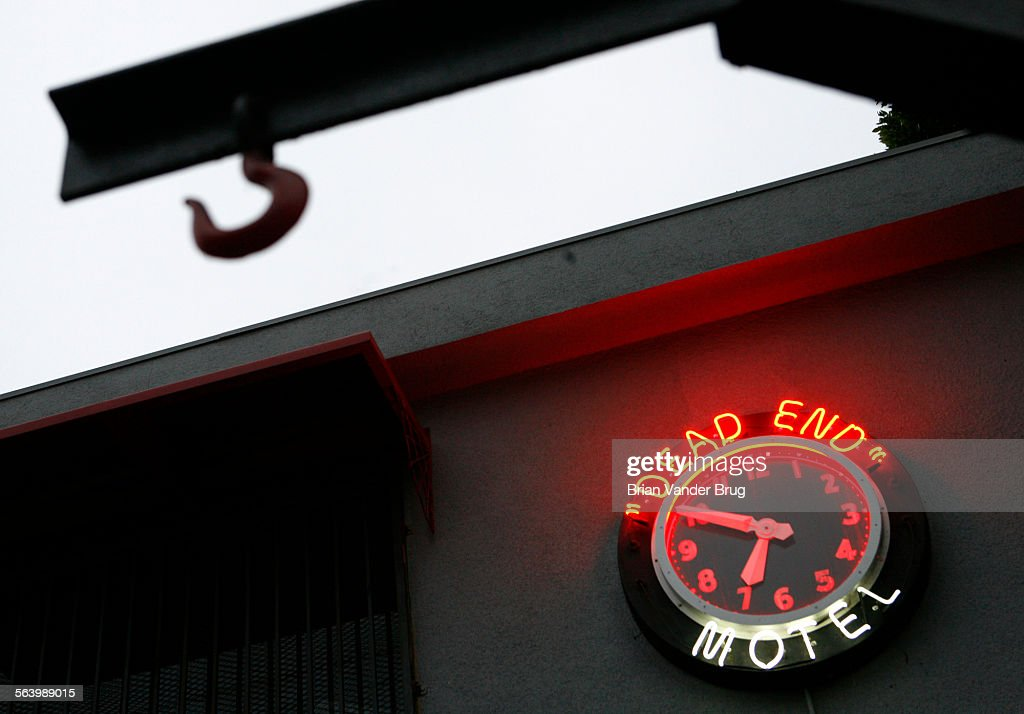 A Neon Clock On The Side Of The 1800autopsy Building With