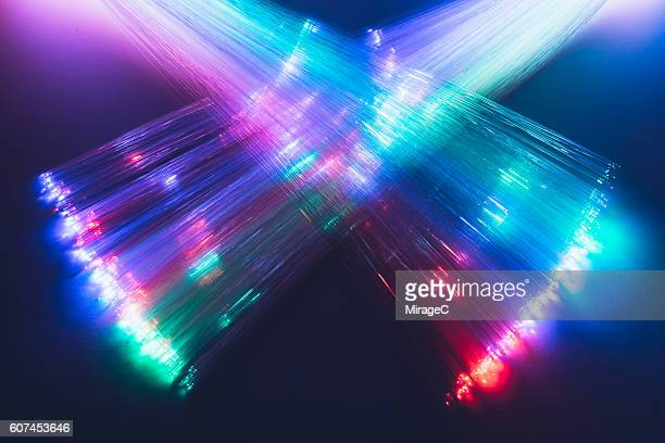 neon colored crisscross fiber optics - transfer image stock pictures, royalty-free photos & images