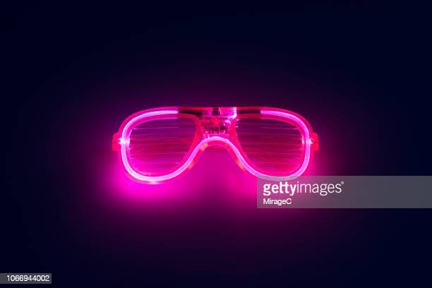 neon colored glowing eyeglasses - neon stock pictures, royalty-free photos & images