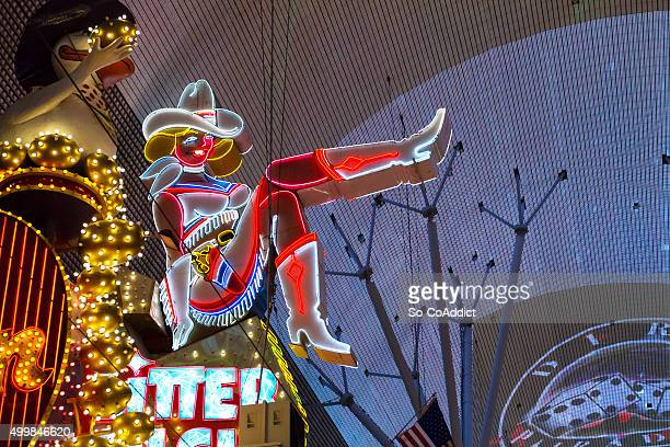 neon cowgirl in las vegas - fremont street las vegas stock pictures, royalty-free photos & images