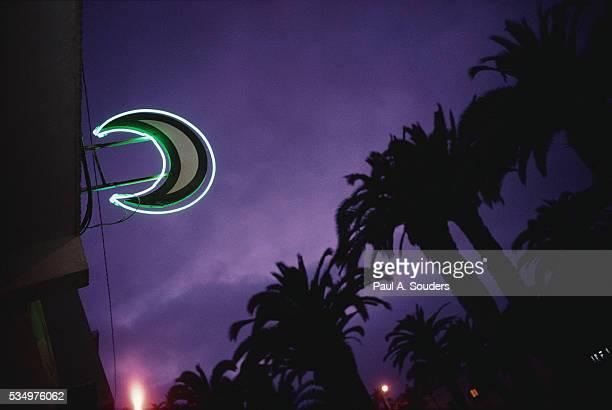 Neon Crescent Moon Above Pharmacy