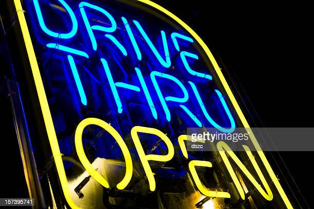 neon drive thru sign blue and yellow