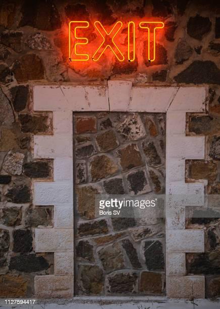 Neon Exit above false door