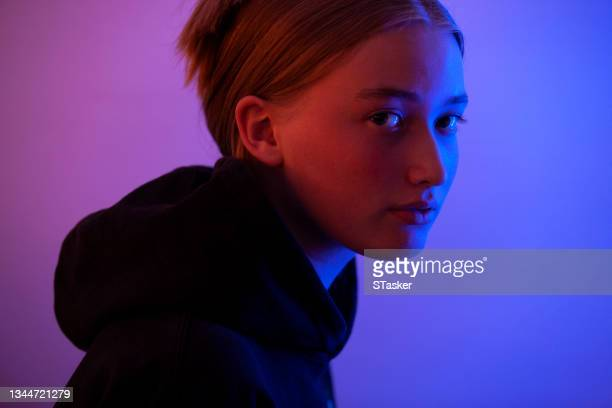 neon girl looking at camera - st. albans stock pictures, royalty-free photos & images