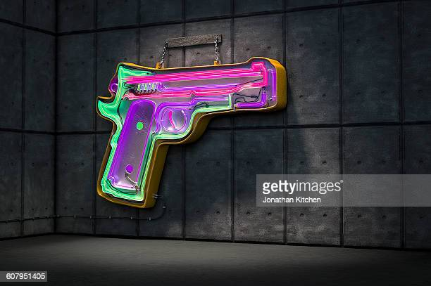 neon gun sign - gun control stock pictures, royalty-free photos & images