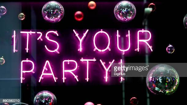 "neon ""it's your party!"" - disco ball stock photos and pictures"
