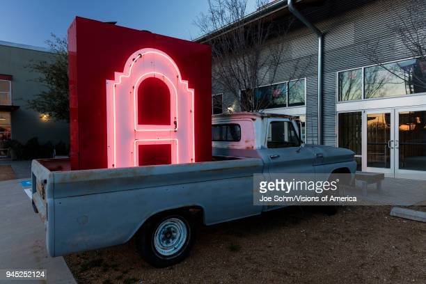 Neon 'Letter A' sign in the backup of old pickup truck on Fort Worth Road outside of Dallas Texas