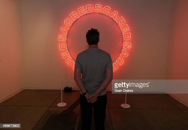 A neon light sculpture by Kendell Geers on display in the Goodman Gallery during Art Basel Miami Beach at the Miami Convention Center in Miami...