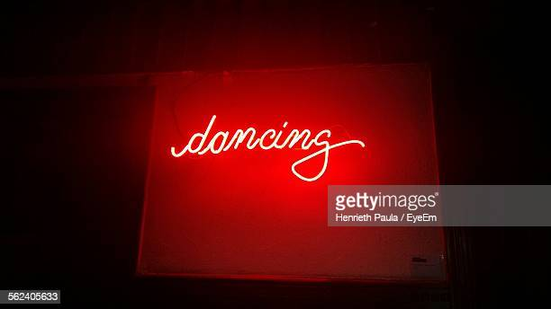 Neon Lighting Word Dancing In Red