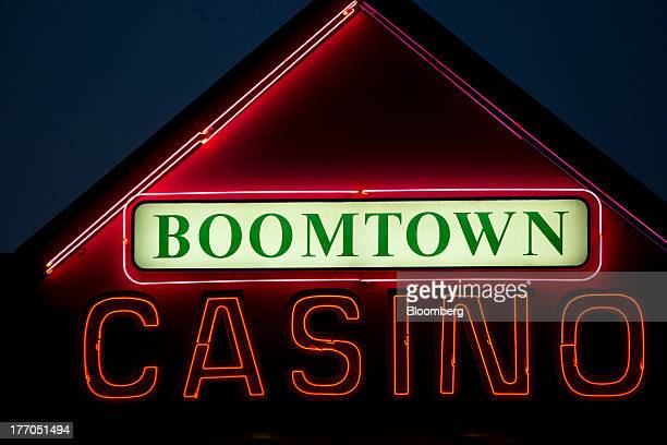 Neon lights advertise the Boomtown Casino in Fort McMurray Alberta Canada on Monday Aug 12 2013 Canadian oil companies have benefited as the gap...