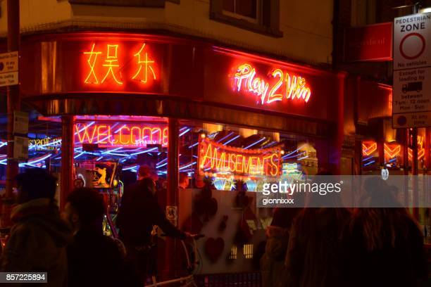 neon lights and people in soho district, london, england - chinatown stock photos and pictures