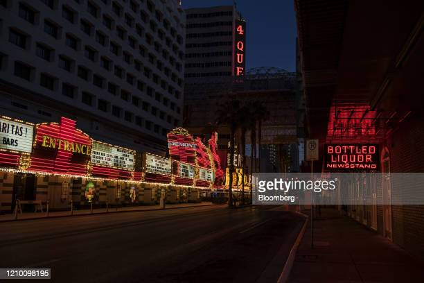Neon lights illuminate an empty street in Las Vegas Nevada US on Wednesday April 15 2020 Nevada's governor ordered all casinos in the state to close...