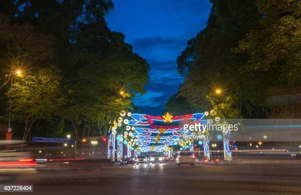 Neon lights line a street during the New Year in Ho Chi Minh city
