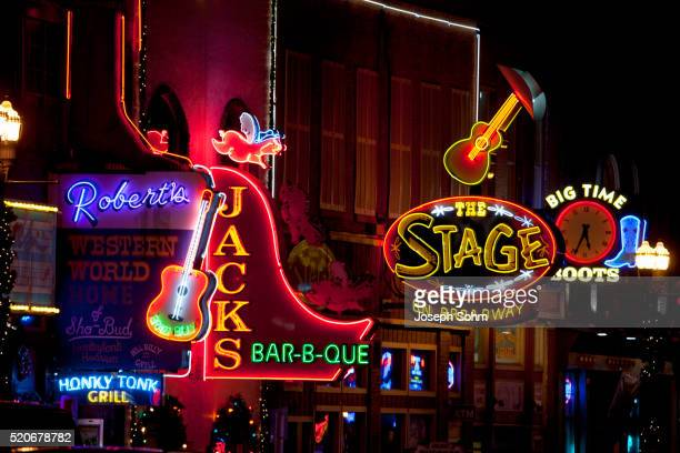 neon lights of lower broadway, nashville, tn - nashville stock pictures, royalty-free photos & images
