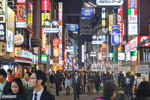 neon lights of the shibuya district - tokyo - mid section stock pictures, royalty-free photos & images