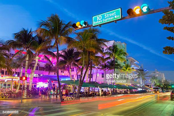 neon lights on ocean drive. - miami stock pictures, royalty-free photos & images