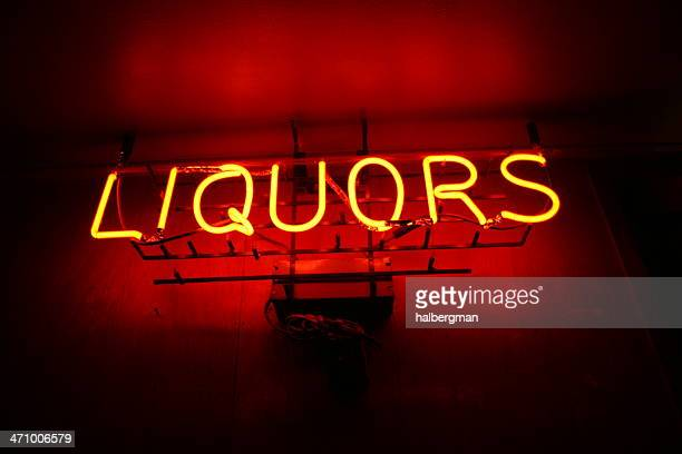 neon liquors sign - speakeasy stock pictures, royalty-free photos & images