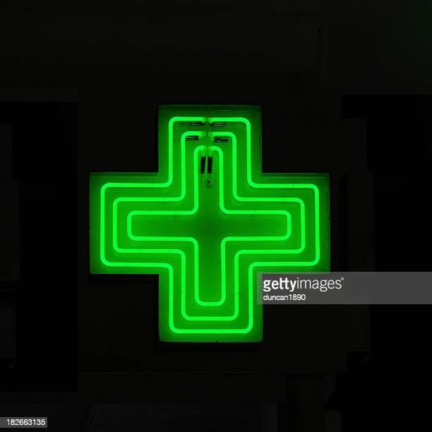 neon medical symbol - erste hilfe hinweisschild stock-fotos und bilder