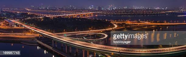 Neon night highway zooming traffic cityscape panorama Seoul Korea