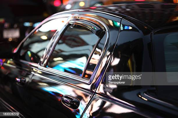 neon nightlife reflected in limo window - prestige car stock pictures, royalty-free photos & images