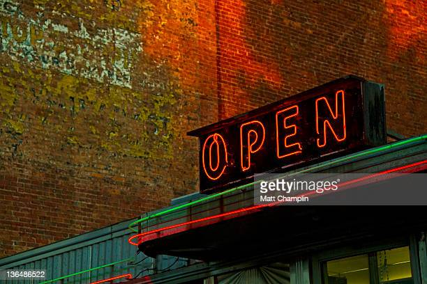 Neon open sign on old diner hotel