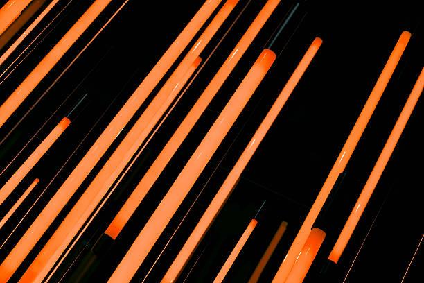 Neon orange rods of glowing light