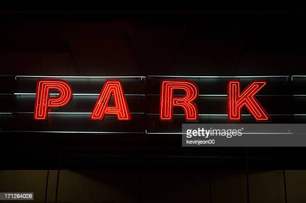 neon parking sign - parking sign stock photos and pictures