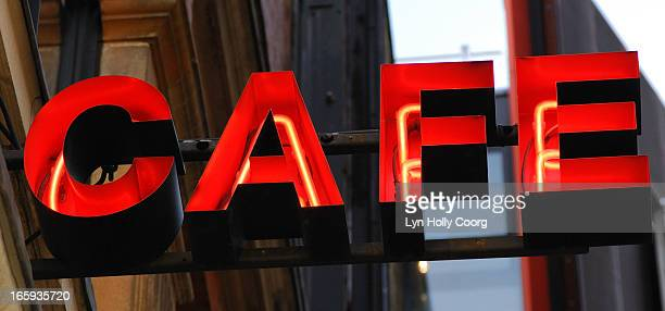 neon red cafe sign - lyn holly coorg stock photos and pictures