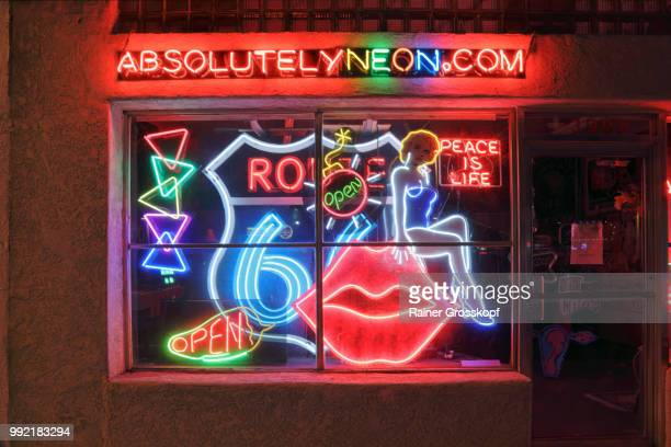 neon shop on route 66 in albuquerque at night - rainer grosskopf stock pictures, royalty-free photos & images