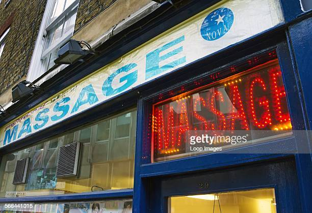 Neon sign above the entrance to a massage parlour in Whitcomb Street near Trafalgar Square