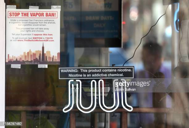 A neon sign advertising Juul ecigarettes is displayed in a window of a tobacco store on June 25 2019 in San Francisco California The San Francisco...