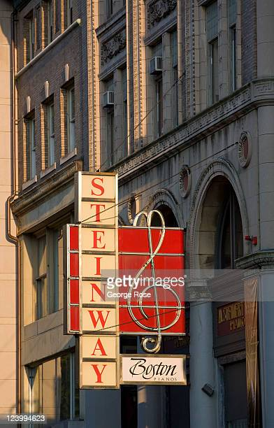 A neon sign at the Steinway piano store on Boylston Street near Boston Common is seen on August 20 2011 in Boston Massachusetts Despite a global...