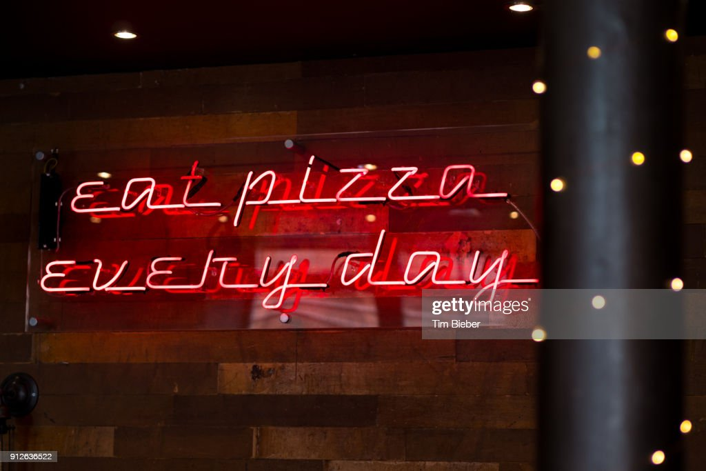 Neon Sign Eat Pizza Every Day Stock Photo - Getty Images