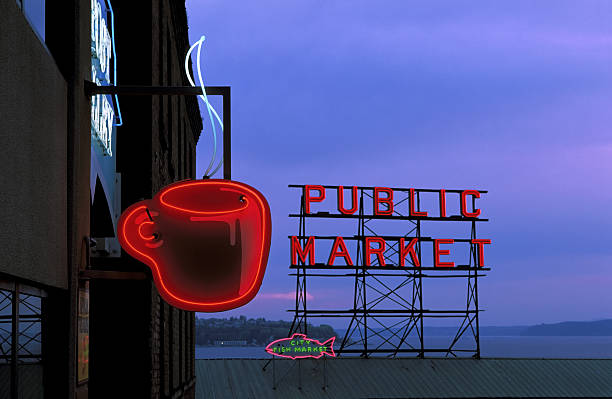 Neon sign for caf? and market at dusk