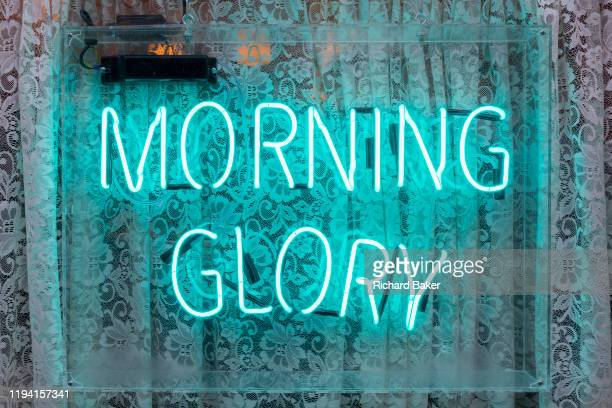 A neon sign forming the letters spelling the word 'Morning Glory' outside a cafe in Soho on 15th January 2020 in London England