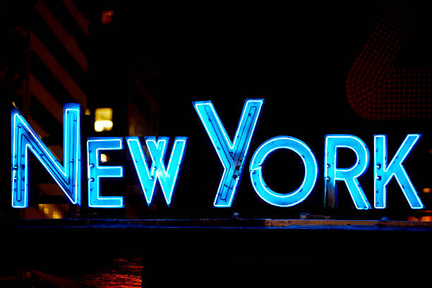 Neon sign glowing at night, Times Square, Manhattan, New York City, New York State, USA