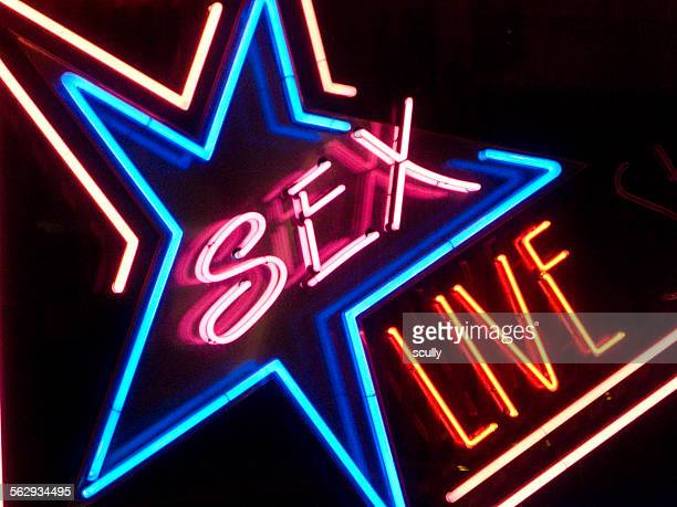 neon sign in a red light district, with the lettering sex live - red light district stock-fotos und bilder