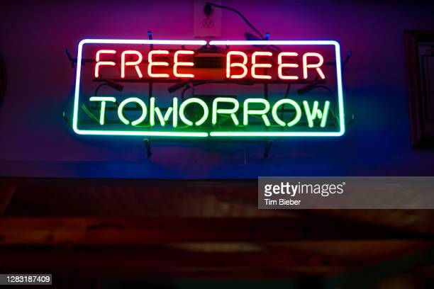 """neon sign in bar """"free beer tomorrow"""" - free stock pictures, royalty-free photos & images"""