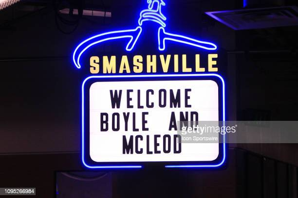A neon sign in the hallway leading to the locker room area of Bridgestone Arena welcomes Nashville Predators center Brian Boyle and left wing Cody...