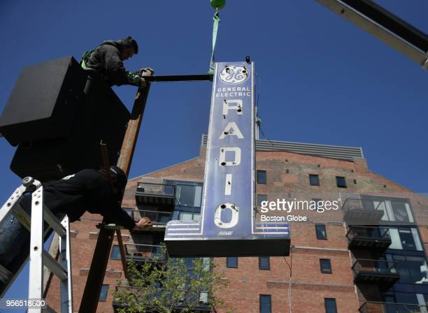 A neon sign is installed on May 8 2018 as part of a public art installation on the Rose Kennedy Greenway in Boston that will feature eight historic...