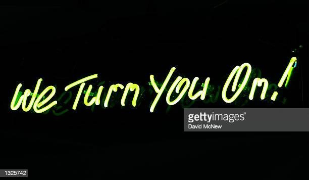 A neon sign is on display at the fifth annual Erotica LA adult entertainment trade show July 14 2001 in Los Angeles CA The convention is open to the...