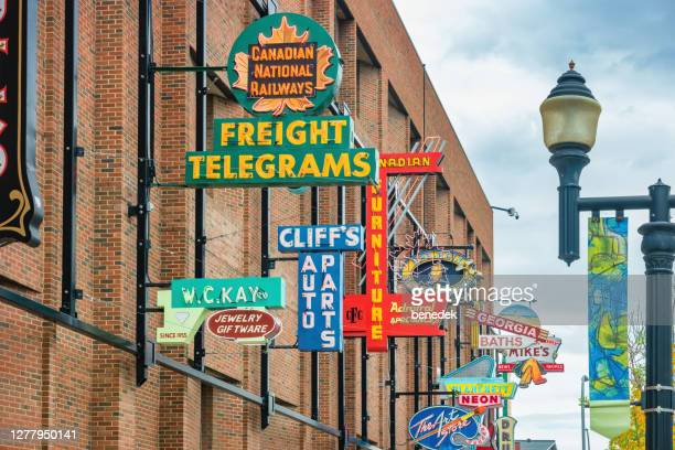 neon sign museum in downtown edmonton alberta canada - edmonton stock pictures, royalty-free photos & images