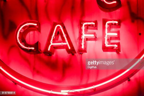 neon sign of cafe - single word stock pictures, royalty-free photos & images