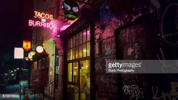 Neon sign of tacos and burritos restaurant in the Lower East Side, Manhattan, New York City