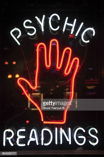 a neon sign on broadway - fortune telling stock pictures, royalty-free photos & images