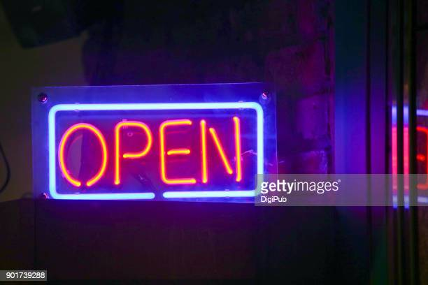 """open"" neon sign - open for business stock pictures, royalty-free photos & images"