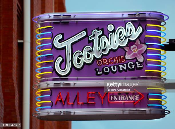 A neon sign points the way to Tootsie's Orchid Lounge an iconic bar and live country music venue in the Lower Broadway entertainment district in...