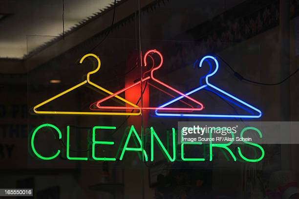 neon sign reading 'cleaners' in window - dry cleaner stock pictures, royalty-free photos & images